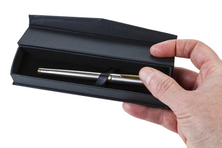 Horizontal photo of open texture pen case and pen with male hand holding it photo