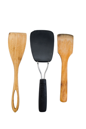 Vertical photo of three kitchen spatulas, two of them wooden, isolated on white Imagens - 23469280