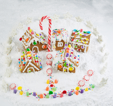 Gingerbread village with surrounding star fence and lots of powered snow photo