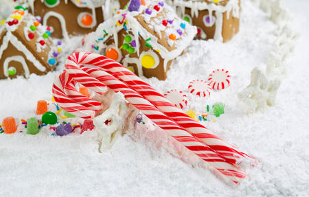 holiday candy canes with Gingerbread houses surrounded by powdered snow photo