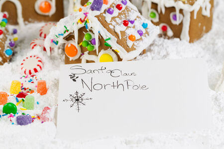 letter to Santa with Gingerbread houses, surrounded by powdered snow photo