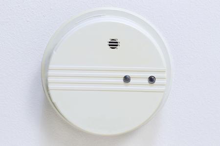 Horizontal photo of home smoke detector with white ceiling  Stok Fotoğraf