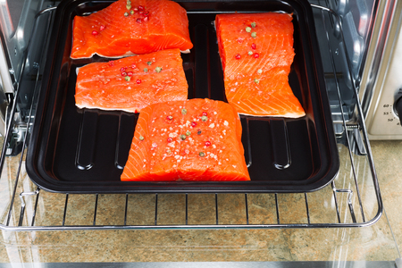 convection: Wild Red Salmon pieces coated with dried red peppercorns and sea salt inside oven