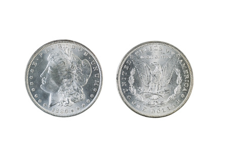 reverse: Closeup photo of a Two Morgan Silver Dollars, obverse and reverse sides, isolated on white