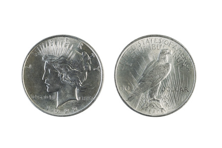 reverse: Closeup photo of a Two Peace Silver Dollars, obverse and reverse sides, isolated on white