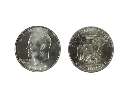 Closeup photo of Eisenhower Silver Dollars, obverse and reverse sides, isolated on white
