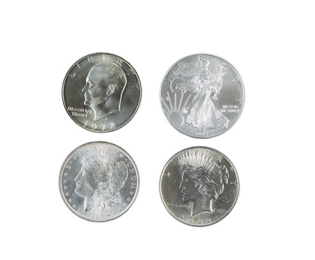 Closeup photo of a Morgan, Peace, Eisenhower and American Eagle Silver Dollars isolated white Stock Photo - 27875892