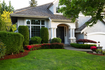 washington landscape: Beautiful home exterior during late spring season with clean landscape
