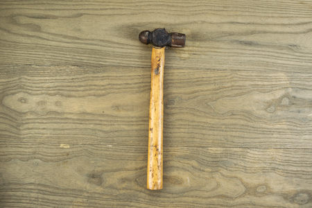 peen: Horizontal photo of an old ball peen hammer on aged wood Stock Photo