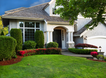 Clean exterior and landscape of residential home    photo