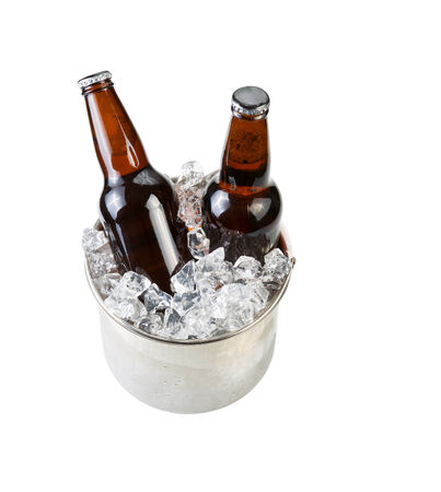 unopen: Vertical photo of glass bottled beer in stainless steel bucket of ice isolated on white