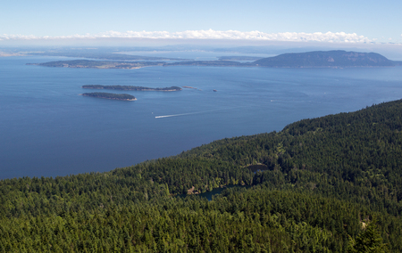 Horizontal photo of San Juan Islands and twin lakes, taken from top of Mount Constitution, during summertime on a nice day photo