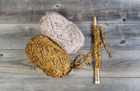 ball of wool: Top view of knitting wool with wooden needles on top of rustic wood