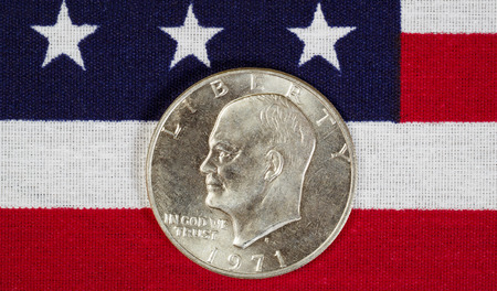 uncirculated: Closeup view of United States Silver Dollar Coins, President Eisenhower, placed on American Flag
