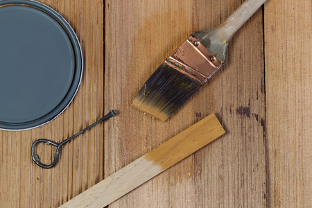 cedar shakes: Closeup top view of painting tools consisting of hand brush, stir stick, can opener and paint lid on cedar untreated wooden shingles  Stock Photo