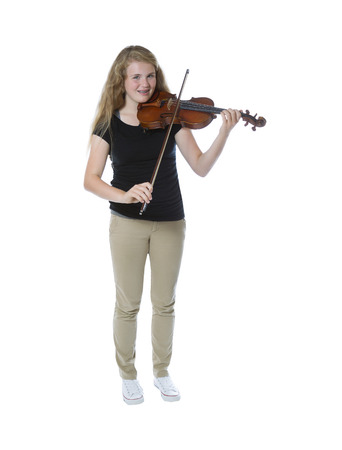 Full body front view of a pretty young teenage girl playing violin isolated on white photo