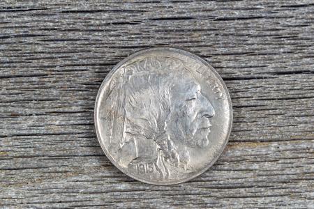 obverse: Closeup image of American Buffalo Nickel, obverse side, on rustic wood