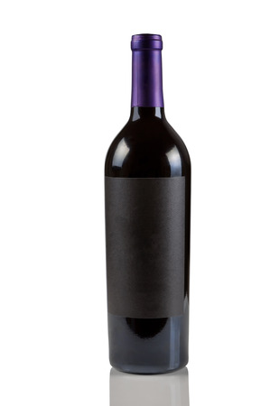 Vertical image of single unopened red wine bottle on white with reflection