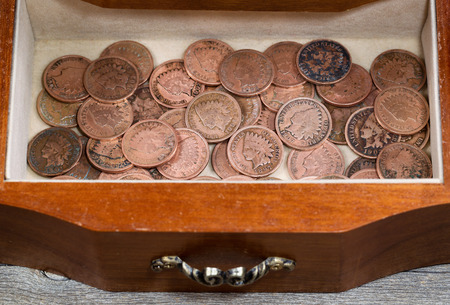 vintage furniture: Image of antique dresser drawer filled with vintage American Indian pennies