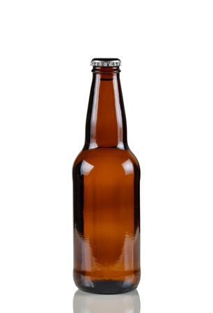 unopened: Closeup vertical image of a single unopened brown beer bottle on white with reflection