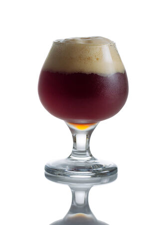 goblet: Fresh dark beer in glass goblet on white with reflection Stock Photo