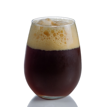 foam party: Fresh dark beer in stemless glass goblet on white with reflection