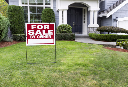 sale sign: Closeup view of Modern Suburban Home for Sale Real Estate Sign in front of modern home Stock Photo