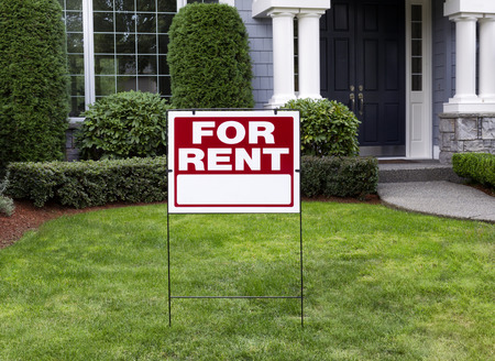 real estate sign: Closeup view of Modern Suburban Home with for Rent Sign in front Yard