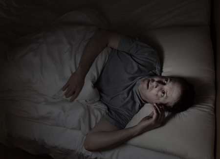 insomnia: Top view image of mature man restless in bed from insomnia Stock Photo