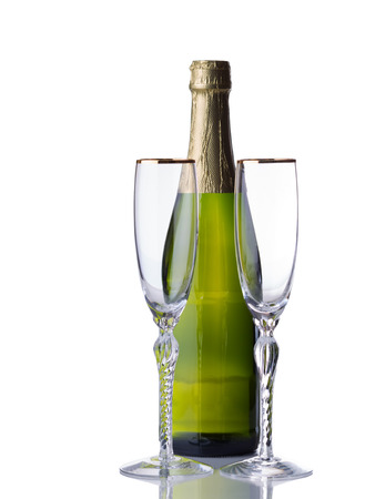 unopened: Empty tall elegant drinking glasses with unopened bottle of sparkling wine isolated over white background with reflection