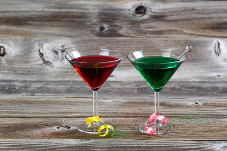 Horizontal image of colorful cocktail drinks on rustic wood with ribbons photo