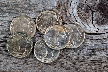 rare animals: Rare buffalo head nickel coins on rustic wood Stock Photo