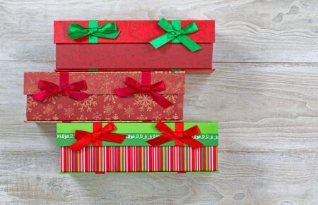 gift wrapped: Top view of holiday gift wrapped boxes on rustic white wood