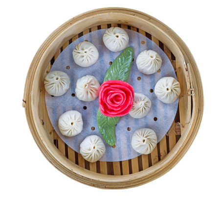 Square top view image of uncooked Chinese Dim sum in bamboo server