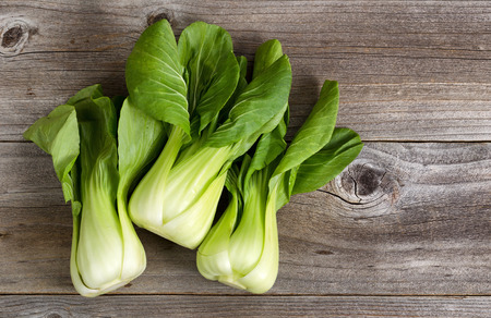 bok choy: Overhead shot of Chinese cabbage, Bok Choy, on rustic wood