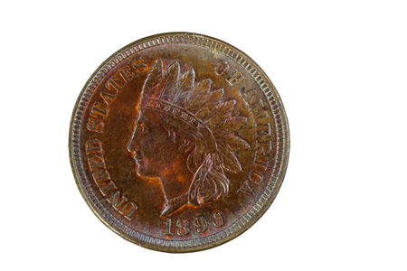 aging process: Indian Head Cent in Mint State Condition isolated on white. Coin showing red and brown colors from copper metal aging process.