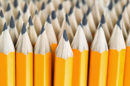 tip up: Close up front image of stacked pencils with focus on tip of centered pencil