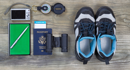essentials: Travel gear basics on aged wooden surface Stock Photo