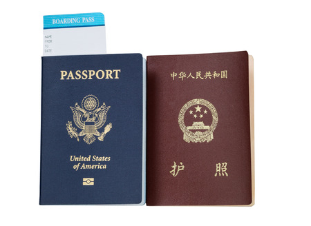 United States and China passport and boarding pass isolated on white background.