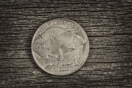 reverse: Vintage concept of Buffalo Nickel, reverse side, on rustic wood Stock Photo