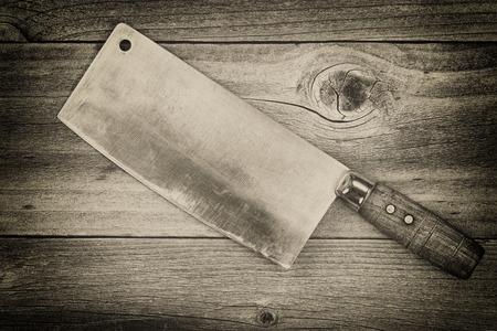 Vintage concept of an large old traditional butcher knife on rustic wood Zdjęcie Seryjne