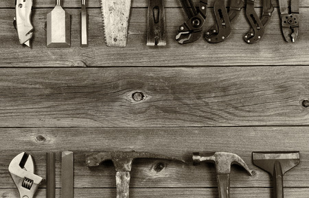 bar tool: Vintage concept of used partial tools forming border on rustic wooden boards.