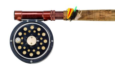 rood: Antique fly fishing reel, flies and rod isolated on white background.