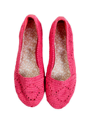 causal clothing: Knitted pink shoes isolated on white.