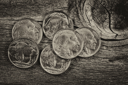 nickel: Vintage concept of old nickel coins on rustic wood Stock Photo