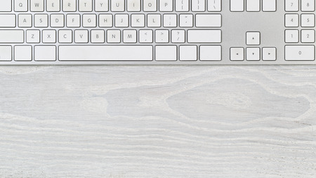 telework: White office table with computer keyboard. Top view with plenty of copy space. Stock Photo