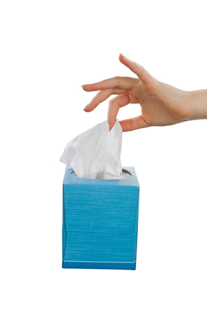 facial tissue: Female hand picking facial tissue from blue napkin box. Isolated on white background. Stock Photo