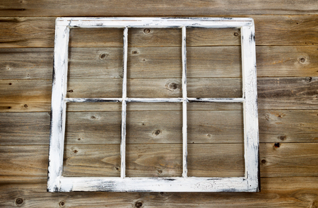 fading: Vintage window fading white paint on rustic cedar wooden boards. Stock Photo