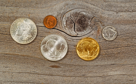 nickel: United States Mint issued American vintage coins, consisting of silver, gold and nickel metals, on rustic wood.