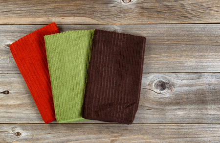 rags: Colorful cleaning rags on rustic wooden boards.